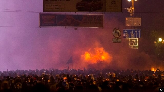 Protesters clash with police in central Kyiv, early Monday, Jan. 20, 2014.