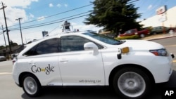 Google's self-driving Lexus car drives along street during a demonstration at Google campus on Wednesday, May 13, 2015, in Mountain View, Calif. (AP Photo/Tony Avelar)