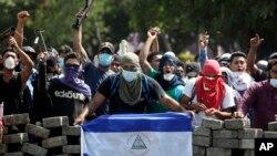 Foto sa a bay yon ide de manifestasyon ki dewoule nan Managwa, Nikaragwa, nan jou ki pase yo.