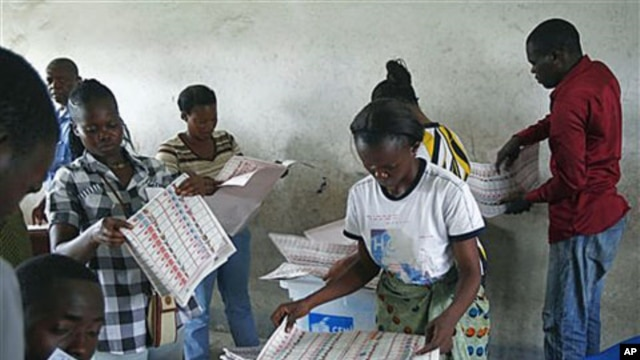Electoral commission workers tally ballots at a polling station in the Bandal commune, one day after the country went to the polls for presidential and parliamentary elections, Kinshasa, Democratic Republic of Congo, November 29, 2011.