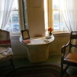 "The half-circle shelf desk where Louisa May Alcott wrote ""Little Women"""