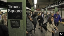 In this 2012 file photo, passengers exit a subway train at New York's Times Square station.