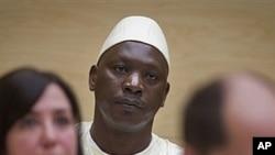Thomas Lubanga (au c.), attendant son verdict à La Haye (14 mars 2012)
