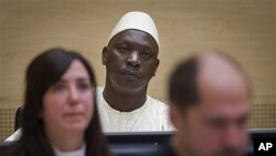 Thomas Lubanga (au c.) attendant son verdict le 14 mars 2012 à la Haye