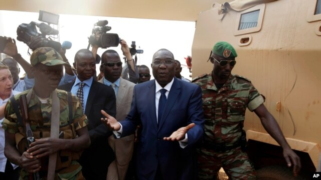 Michel Djotodia, Central African Republic's president, walks back to the Chadian armored vehicle he arrived in following his meeting with US Ambassador to the United Nations Samantha Power at the airport in Bangui, Central African Republic, Thursday Dec.