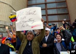 Opposition leader Juan Guaido supporters celebrate during the eviction and arrest of Nicolas Maduro's supporters from the Venezuelan Embassy in Washington, May 16, 2019.