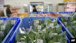 Local spinach on sale at a farmers cooperative in Nihonmatsu, Fukushima prefecture, where many still shun regional produce, March 7, 2012.