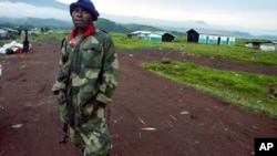 A Congolese army (FARDC) soldier stands outside the deserted town of Kibumba, May 8, 2012.