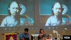 西藏流亡政府發言人桑杰嘉在香港一個西藏研討會,透過視訊會與參加者對話