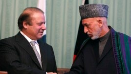 Afghan President Hamid Karzai (on right) and Pakistani Prime Minister Nawaz Sharif at a joint news conference in Kabul last month.