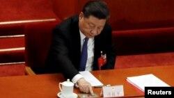 Çin Devlet Başkanı Xi Jinping de yasanın kabulü yönünde oy kullandı.