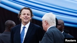 U.N. Special Representative to Mali, Albert Koenders (L), at a ceremony that marks the beginning of the 12,000-strong U.N. peacekeeping mission in Mali (MINUSMA) in Bamako, July 1, 2013