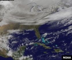 NOAA's GOES-East satellite provided a look at the frigid eastern two-thirds of the U.S. on Jan. 7, 2015, that shows a blanket of northern snow, lake-effect snow from the Great Lakes and clouds behind the Arctic cold front.