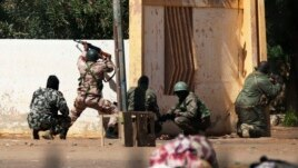 Malian soldiers fire at Islamists' positions at the mayor's office, in Gao, Mali, February 21, 2013.