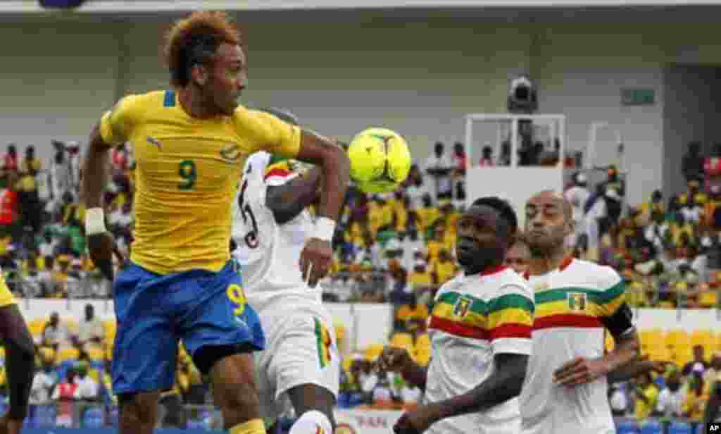 Gabon striker Pierre-Emerick Aubameyang (9) attempts to score during their quarter-final match of the 2012 African Cup of Nations football tournament against Mali at the Stade De L'Amitie Stadium in Gabon's capital Libreville February 5, 2012.
