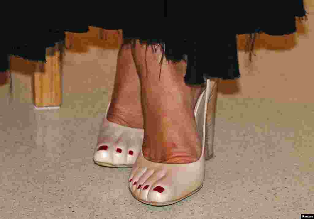The shoes of Princess Caroline of Hanover are seen at the fundraising dinner for the new national museum, in Monaco, Sept. 17, 2013.