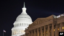 FILE - In this April 7, 2011, file photo the U.S. Capitol in Washington is illuminated at night as Congress work late to avert a government shutdown. The legislative branch of the world's most powerful nation is now widely scorned as it lurches from one n