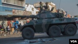 FILE: An army tank patrols on a street in Harare during protests by opposition party supporters Wednesday, Aug. 1, 2018. Hundreds of angry opposition supporters outside Zimbabwe's electoral commission were met by riot police firing tear gas as the country awaited the results of Monday's presidential election, the first after the fall of longtime leader Robert Mugabe. (AP Photo/Mujahid Safodien)