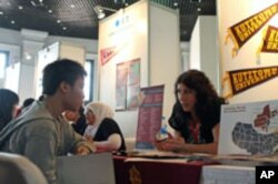 A recruiter answers questions from an Indonesian student looking to study in the US, at a US education fair sponsored by the US Embassy in Jakarta, April 4, 2011