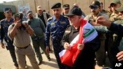 Firaminista Haider al-Abadi a Birnin Mosul rike da Tutar Iraki