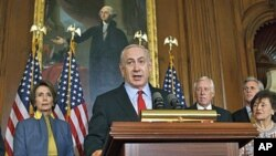 Israeli Prime Minister Benjamin Netanyahu, accompanied by House of Representatives members, gestures during a news conference on Capitol Hill in Washington, March 6, 2012.