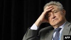 Ông George Soros là nhân vật tiếng tăm mới nhất đã đến thăm khôi nguyên giải Nobel hòa bình kể từ khi bà được phóng thích cách đây 1 năm