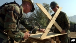 U.S Navy Mobile Construction Battalion 74 from Gulfport, Missisisippi made a table in Muzaffarabad, Pakistan, Monday, Oct 31, 2005. (AP Photo/ Achmad Ibrahim)