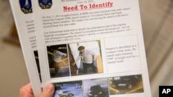 美国南卡罗莱纳州当局散发通缉传单,上面印有涉嫌枪手进入教堂时被摄像镜头拍下的照片(2015年6月18)