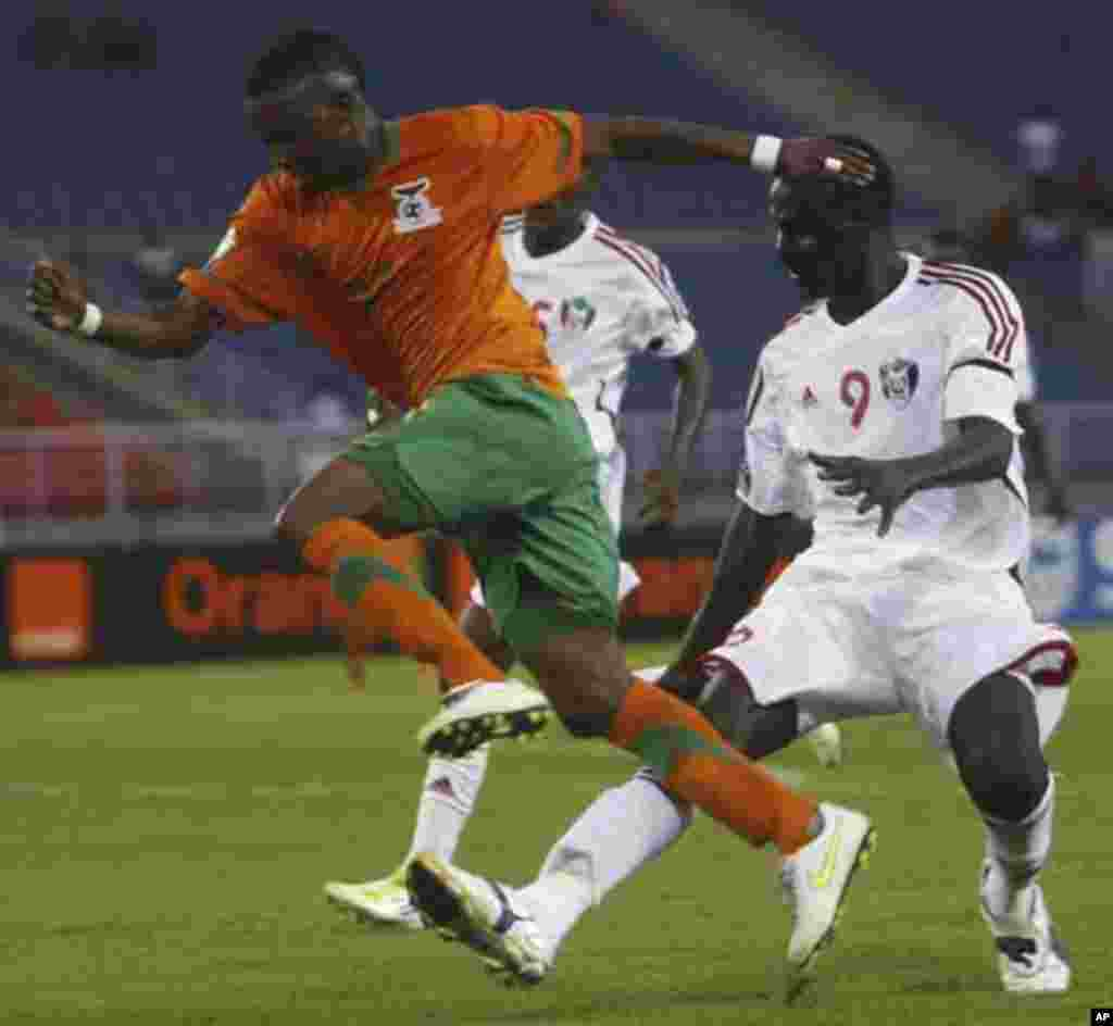 "Saif Eldin Ali Idris Farah of Sudan challenges Rainford Kalaba of Zambia (L) during their African Nations Cup quarter-final soccer match at Estadio de Bata ""Bata Stadium"", in Bata February 4, 2012."