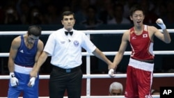 Olimpiadadakı qalmaqallı boks döyüş fotolarda