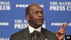 Republican presidential candidate Herman Cain answers questions at the National Press Club in Washington (file photo)