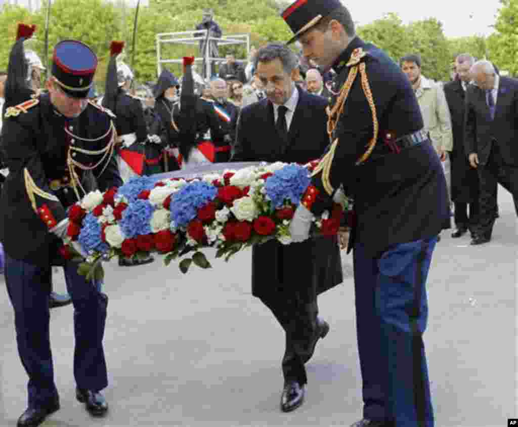 French President and candidate for the French presidential election Nicolas Sarkozy stands before the Armenian Monument during a ceremony marking the 97th anniversary of the Armenian genocide, Tuesday, April. 24, 2012. (AP Photo / Jacques Brinon , Pool