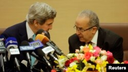U.S. Secretary of State John Kerry talks with Algeria's Foreign Minister Ramtane Lamamra (R) before addressing a news conference at the Foreign Ministry in Algiers, April 3, 2014.