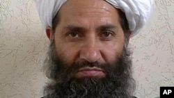 FILE -An undated photo in an unknown location shows the new leader of the Afghanistan Taliban Maulvi Haibatullah Akhunzadah posing for a portrait.