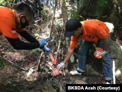 Tim Inafis dari Polres Aceh Selatan saat melakukan indentifikasi terhadap tiga bangkai harimau Sumatera di Desa Ie Buboh, Kecamatan Meukek, Kabupaten Aceh Selatan, Aceh, (Courtesy: BKSDA Aceh)