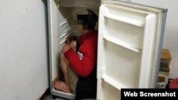 Cảnh sát Đài Loan phát hiện một lao động Việt trốn trong tủ lạnh. Photo Central News Agency.