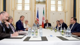U.S. Secretary of State John Kerry - flanked by National Security Council Senior Director for Iran, Iraq, Syria and the Gulf States Robert Malley, U.S. Energy Secretary Dr. Ernest Moniz, Under Secretary of State for Political Affairs Wendy Sherman, and Eu