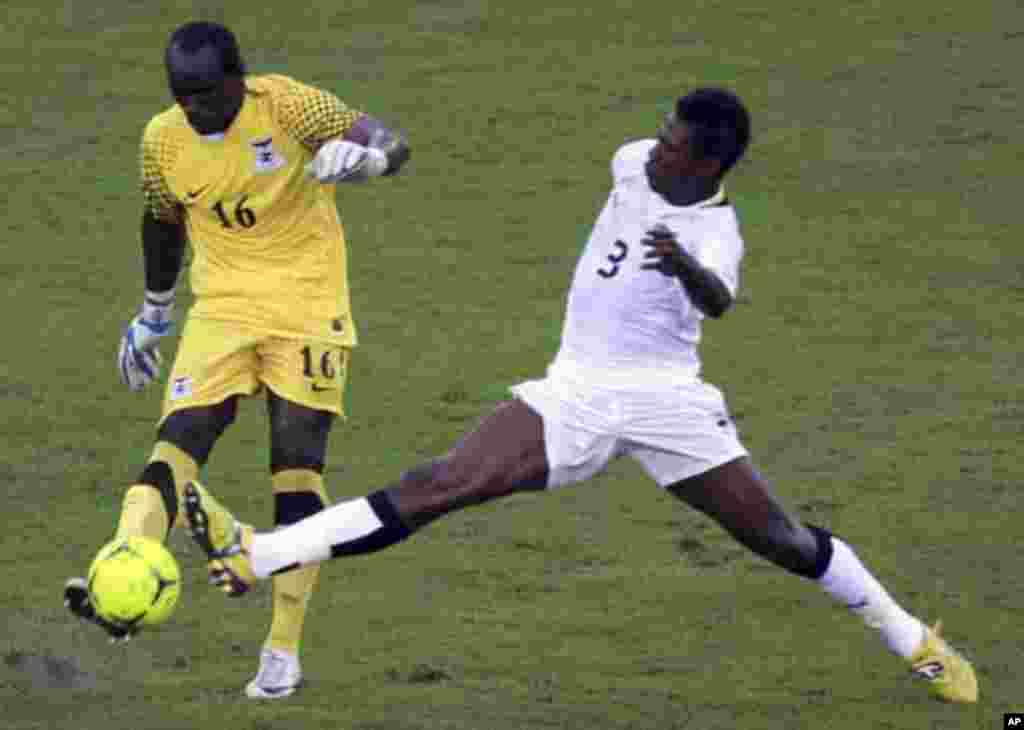 "Asamoah Gyan of Ghana (R) fights for the ball with Zambia's goalkeeper Kennedy Mweene during their African Nations Cup semi-final soccer match at Estadio de Bata ""Bata Stadium"" in Bata February 8, 2012."