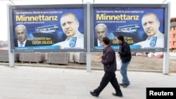FILE - Pedestrians look at billboards with the pictures of Turkey's then prime minister, now President Recep Tayyip Erdogan (R) and his Israeli Prime Minister Benjamin Netanyahu, in Ankara, Turkey, March 25, 2013. The billboard was posted after Israel apo
