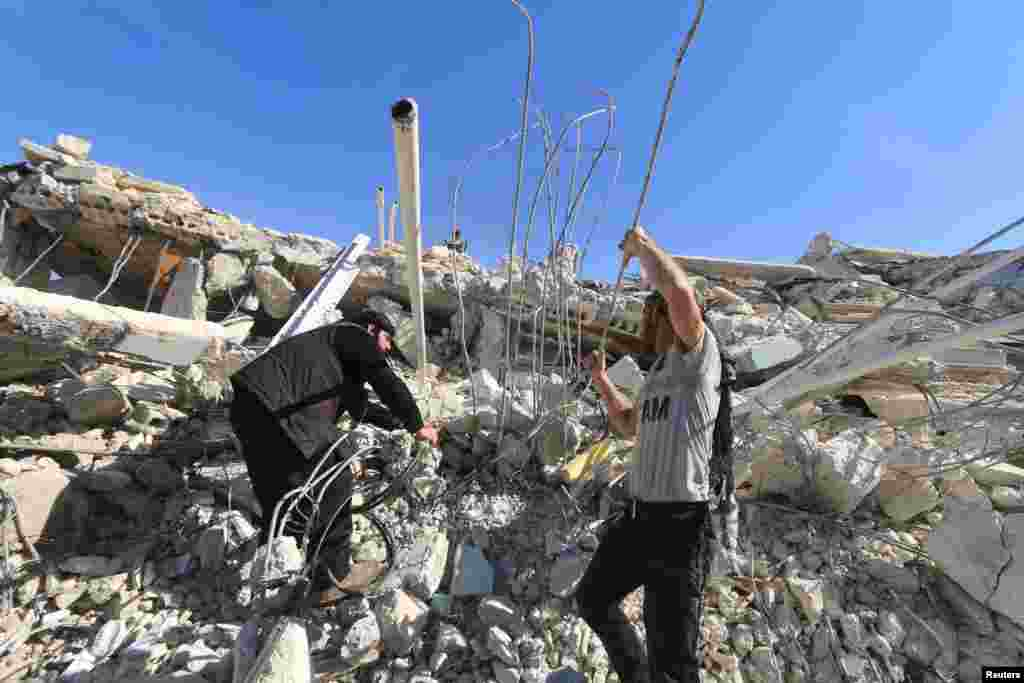 People look for survivors in the ruins of a destroyed Medecins Sans Frontieres (MSF) supported hospital hit by missiles in Marat Numan, Idlib province, Syria.