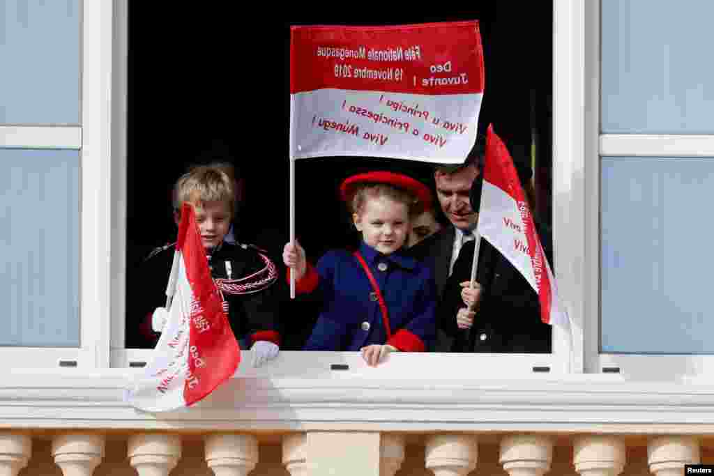 Monaco's Prince Jacques and Princess Gabriella stand on the palace balcony during the celebrations marking Monaco's National Day.