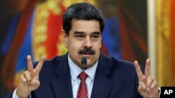 Venezuela's President Nicolas Maduro gestures as he speaks during a news conference at Miraflores Palace in Caracas, Venezuela January 25, 2019