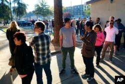 Voters wait at the North Hollywood Amelia Earhart Regional Library in Los Angeles on Nov. 8, 2016.