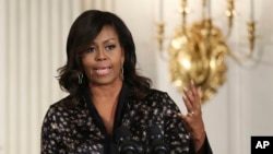Michelle Obama Racist Post: FILE - In this Friday, Oct. 21, 2016, file photo, first lady Michelle Obama speaks to student participants during a Grammy Museum musical workshops hosted by the first lady in the East Room of the White House in Washington. Clay Town, W.Va. Mayor Beverly Whaling resigned her post Tuesday, Nov. 15, following a backlash after she posted a response to a racist comment about the first lady on Facebook.