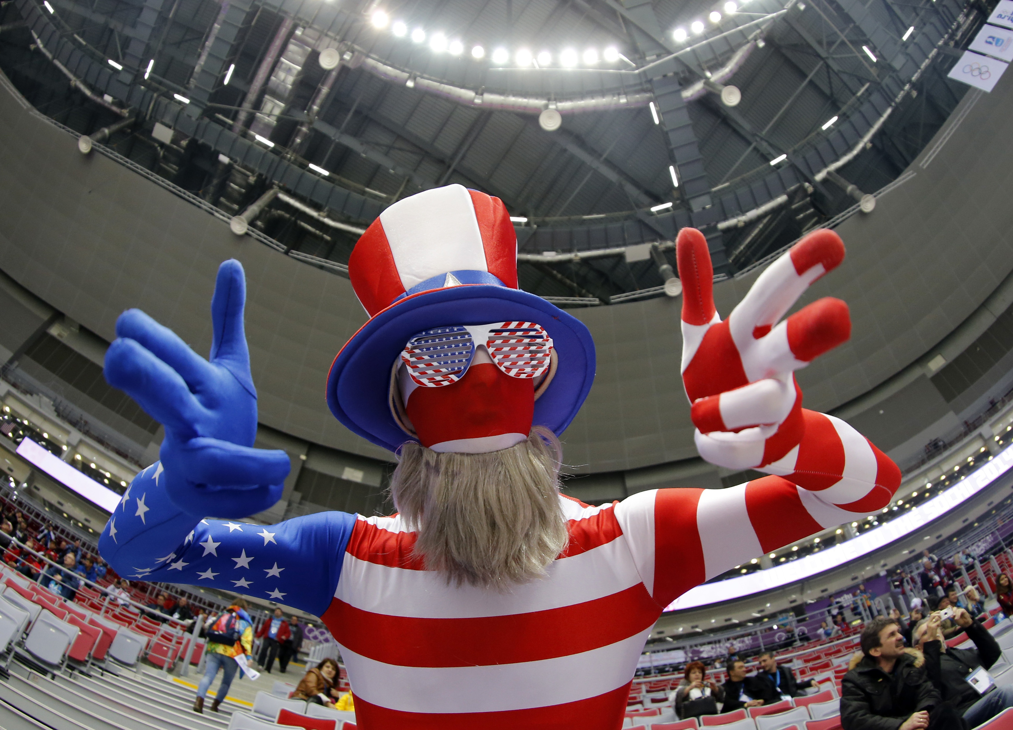 A fan of the U.S. dressed in a costume in the colours of their national flag gestures ahead of their women's ice hockey gold medal game against Canada at the Sochi 2014 Winter Olympic Games February 20, 2014.