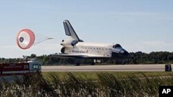 FILE - Space shuttle Atlantis lands on Runway 33 at NASA Kennedy Space Center's Shuttle Landing Facility, concluding the STS-129 mission, Nov. 27, 2009.
