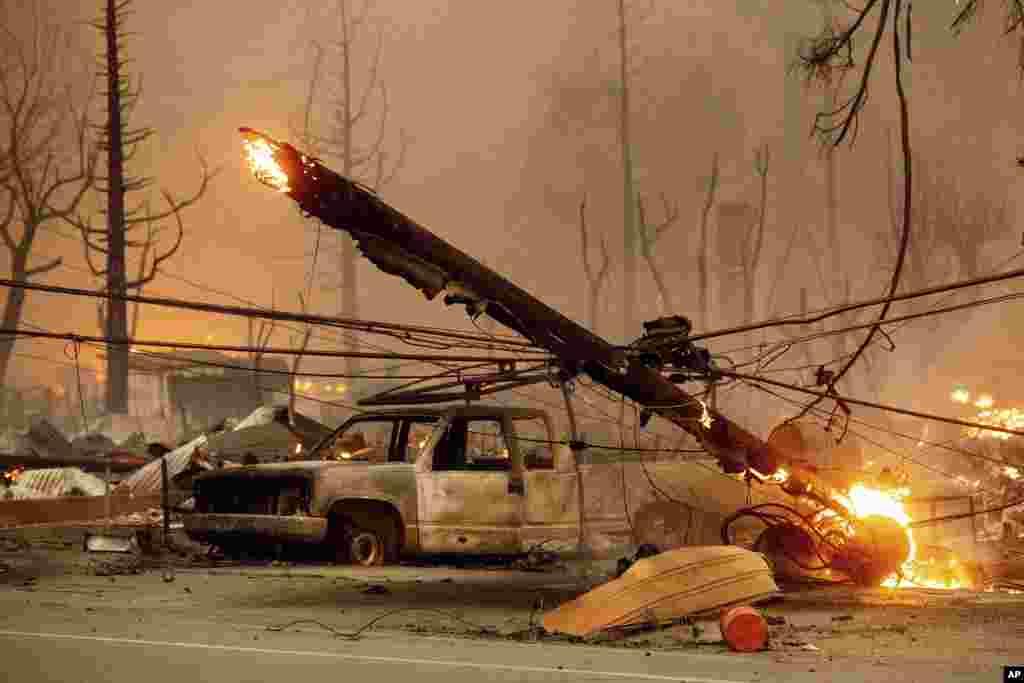 A utility pole burns as the Dixie Fire tears through the Greenville community of Plumas County, California, Aug. 4, 2021.