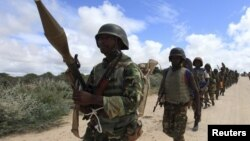 FILE - African Union Mission in Somalia (AMISOM) soldiers from Burundi patrol on the outskirts of Mogadishu, Somalia, May 22, 2012.