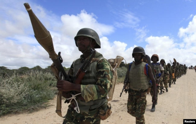 FILE - African Union Mission in Somalia (AMISOM) soldiers from Burundi patrol on the outskirts of Mogadishu, Somalia, May 22, 2012.