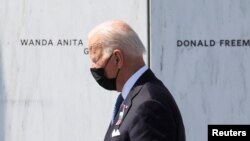 U.S. President Joe Biden visits the wall of the names of the victims on the 20th anniversary of the September 11, 2001 attacks, at the Flight 93 National Memorial in Stoystown, Pennsylvania, U.S., September 11, 2021.